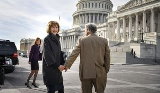 Holding hands with her husband Archie, former Minnesota Lt. Gov. Tina Smith enters the U.S. Capitol, Wednesday, Jan. 3, 2018, to be administered the Senate oath of office on Capitol Hill in Washington. Smith was appointed to replace Sen. Al Franken, who resigned amid allegations of sexual misconduct. (Glen Stubbe/Star Tribune via AP) ** FILE **