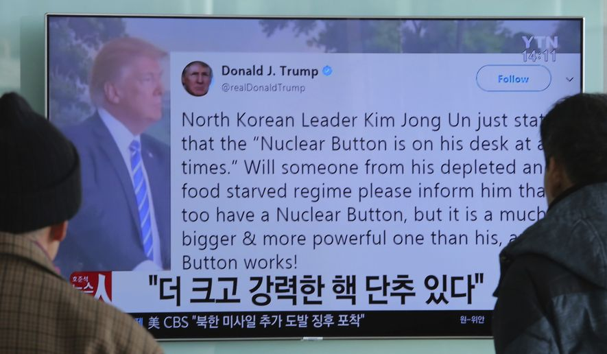 "People watch a TV news program showing the Twitter post of U.S. President Donald Trump while reporting North Korea's nuclear issue, at Seoul Railway Station in Seoul, South Korea, Wednesday, Jan. 3, 2018. Trump boasted that he has a bigger and more powerful ""nuclear button"" than North Korean leader Kim Jong Un does  but the president doesn't actually have a physical button. The letters on the screen read: ""More powerful nuclear button."" (AP Photo/Ahn Young-joon)"