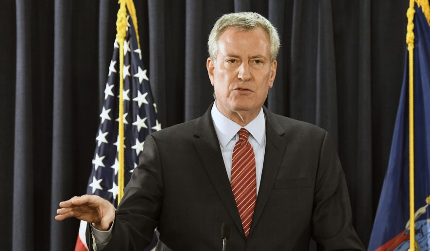 """It's time for them to start paying for the damage they have done,"" said New York City Mayor Bill de Blasio at a press conference at the Manhattan Youth Center. ""It's time for big oil to take responsibility for the devastation they have wrought."" (AP Photo/Hans Pennink)"
