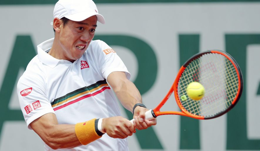 FILE - In this Monday, June 5, 2017 file photo, Japan's Kei Nishikori returns the ball to Spain's Fernando Verdasco during their fourth round match of the French Open tennis tournament at the Roland Garros stadium in Paris. Kei Nishikori's agent says the 2014 U.S. Open runner-up is pulling out of the Australian Open. Olivier van Lindonk says in an email Wednesday, Jan. 3, 2018 that Nishikori is not ready to play best-of-five-set matches as he returns from an injured right wrist that has sidelined him since August. (AP Photo/Christophe Ena, File)