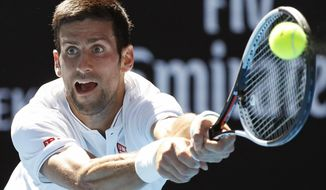"""FILE - In this Jan. 19, 2017, file photo, Serbia's Novak Djokovic makes a backhand return to Uzbekistan's Denis Istomin during their second round match at the Australian Open tennis championships in Melbourne, Australia.  Dkokovic is still not sure whether he will be able to play in the Australian Open, where has won six of his 12 major championships. Djokovic has been dealing with pain in his right elbow. A statement posted on his website Wednesday, Jan. 3, 2017,  says he will travel to Australia to participate in two exhibition events next week. After that, the statement says, """"the decision will be made about his participation at the first Grand Slam of the season.""""(AP Photo/Kin Cheung, File)"""