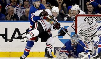 New York Rangers right wing Jesper Fast (17) gets tangled up with Chicago Blackhawks center Jonathan Toews (19) during the second period of an NHL hockey game, Wednesday, Jan. 3, 2018, in New York. (AP Photo/Julie Jacobson)