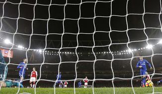 Chelsea's Eden Hazard scores his side's first goal during the English Premier League soccer match between Arsenal and Chelsea at Emirates stadium in London, Wednesday, Jan. 3, 2018. (AP Photo/Frank Augstein)