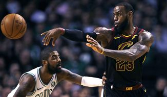 Cleveland Cavaliers forward LeBron James (23) passes the ball as Boston Celtics guard Kyrie Irving defends during the second quarter of an NBA basketball game in Boston, Wednesday, Jan. 3, 2018. (AP Photo/Charles Krupa)