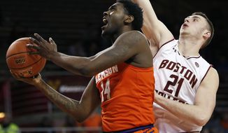 Clemson's Elijah Thomas (14) shoots in front of Boston College's Nik Popovic (21) during the first half of an NCAA college basketball game in Boston, Wednesday, Jan. 3, 2018. (AP Photo/Michael Dwyer)