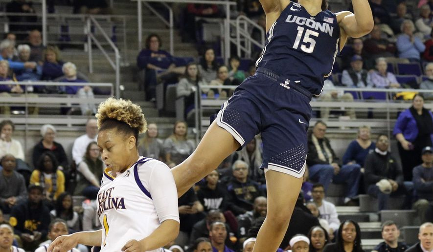 Connecticut's Gabby Williams (15) shoots over East Carolina's Alexandra Frazier during the first half of an NCAA college basketball game in Greenville, N.C., Wednesday, Jan. 3, 2018. (AP Photo/Gerry Broome)