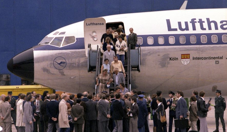 FILE - In this Oct. 18, 1977 file photo the first freed hostages step down the gangway after landing at Frankfurt am Main's airport, in West Germany. Ulrich Wegener, the commander of the German paramilitary unit that ended the hijacking of a plane by Palestinian militants in 1977 has died.  (AP Photo/Dieter Endlicher)