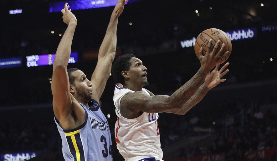 Los Angeles Clippers' Lou Williams, right, goes up for a basket past Memphis Grizzlies' Brandan Wright during the second half of an NBA basketball game Tuesday, Jan. 2, 2018, in Los Angeles. The Clippers 113-105. (AP Photo/Jae C. Hong)