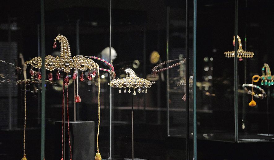 Some jewels are on display at the 'Treasures of the Mughals and the Maharajahs' exibithion, at Venice's Doge's Palace, in Venice, Italy, Wednesday, Jan. 3, 2018. News reports say thieves stole precious Indian jewels from the famed Al Thani Collection that were on exhibit, the thieves grabbed a golden, jeweled brooch and a pair of earrings Wednesday and escaped by blending in with the crowd and delaying the triggering of the alarm.  (Andrea Merola/ANSA via AP)