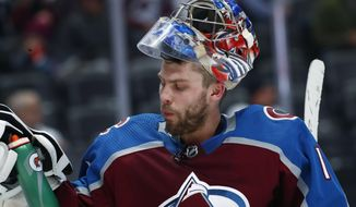 Colorado Avalanche goaltender Semyon Varlamov, of Russia, takes a drink during a timeout against the Winnipeg Jets in the second period of an NHL hockey game Tuesday, Jan. 2, 2018, in Denver. Varlamov was pulled from the ice in the period and replaced by backup goalie Jonathan Bernier. (AP Photo/David Zalubowski)