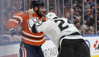 Los Angeles Kings' Derek Forbort (24) and Edmonton Oilers' Patrick Maroon (19) fight during the second period of an NHL hockey game in Edmonton, Alberta, Tuesday, Jan. 2, 2018. (Jason Franson/The Canadian Press via AP)