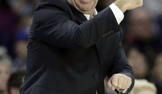Notre Dame coach Mike Brey gestures during the second half of the team's NCAA college basketball game against North Carolina State in South Bend, Ind., Wednesday, Jan. 3, 2018. (AP Photo/Michael Conroy)