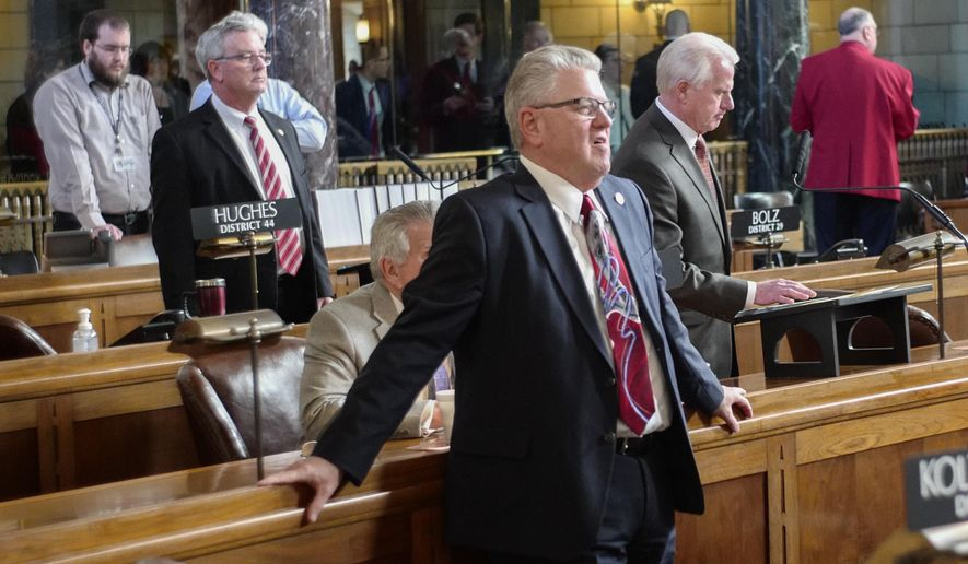 Neb. Speaker of the Legislature Sen. Jim Scheer of Norfolk, stands in the Legislative Chamber on the first day of the 2018 legislative session in Lincoln, Neb., Wednesday, Jan. 3, 2018. Scheer said he's confident lawmakers will have a positive, productive session this year but acknowledged he may be more optimistic than others. Lawmakers begin the 2018 session with a looming state revenue shortfall that could make it harder to pass new spending measures or tax cuts. (AP Photo/Nati Harnik)