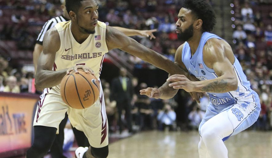 Florida State's Trent Forrest works against the defense of North Carolina's Joel Berry in the ...