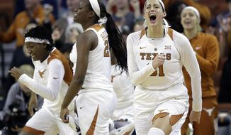 Texas forward Audrey-Ann Caron-Goudreau (31) and teammates celebrate their 84-79 win over Oklahoma State in an NCAA college basketball game, Wednesday, Jan. 3, 2018, in Austin, Texas. (AP Photo/Eric Gay)