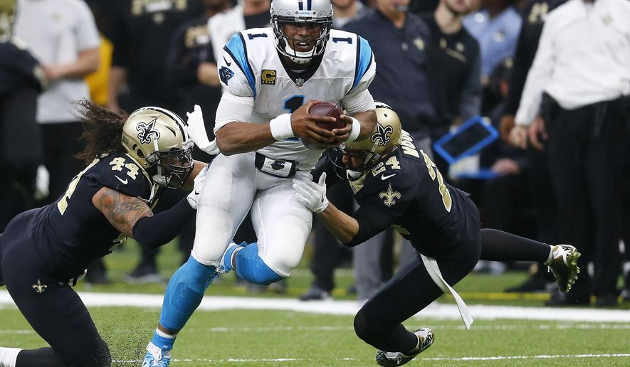 FILE - In this  Sunday, Dec. 3, 2017 file photo, Carolina Panthers quarterback Cam Newton (1) tries to avoid the tackle by New Orleans Saints outside linebacker Hau'oli Kikaha (44) and cornerback Sterling Moore (24) in the second half of an NFL football game in New Orleans. Cam Newton knows the Panthers will be walking into a pressure-packed environment Sunday, Jan. 7, 2018 when they face the New Orleans Saints at the Superdome in an NFC wild card game. (AP Photo/Butch Dill, File)