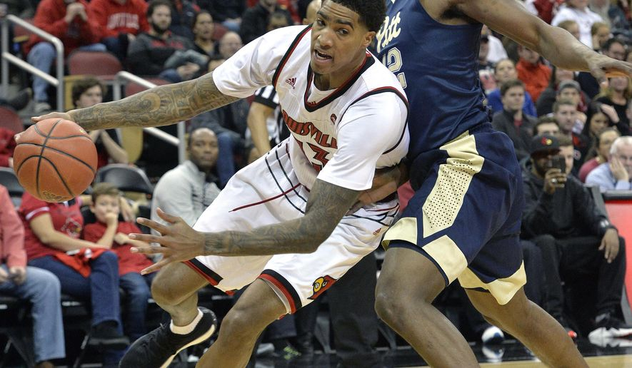 Louisville forward Ray Spalding (13) works his way around the screen of Pittsburgh forward Terrell Brown (21) during the second half of an NCAA college basketball game, Tuesday, Jan. 2, 2018, in Louisville, Ky. Louisville won 77-51. (AP Photo/Timothy D. Easley)