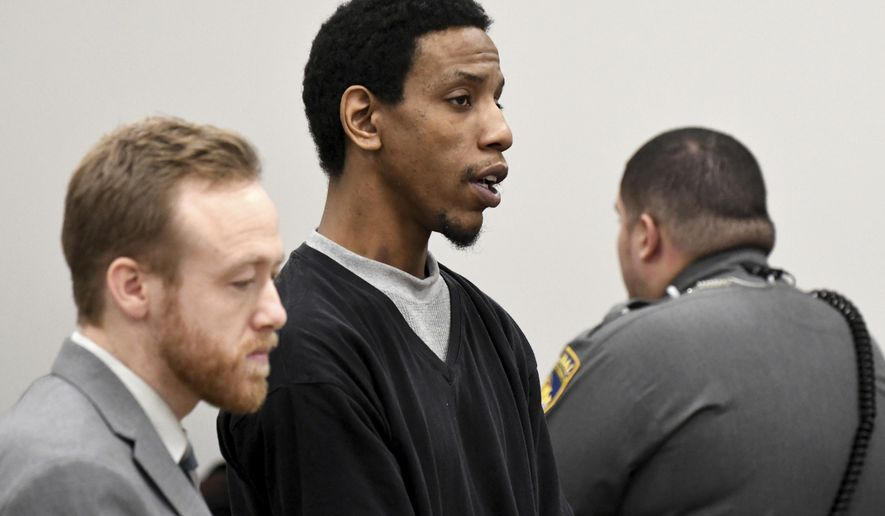 James Goolsby, center, alongside public defender Russell Williams, left, pleads not guilty during his arraignment, Wednesday, Jan. 3, 2018, at Manchester Superior Court in Manchester, Conn. Police charged the 28-year-old with murder in the death of 36-year-old Norris Jackson, who was shot at the Bonchon Chicken restaurant in Manchester just before noon last Saturday. He is being held in lieu of a $1 million bond. Goolsby girlfriend, 23-year-old Leanne Robitaille, was charged with hindering prosecution. She was in custody on a bond of $100,000. (Jim Michaud/Journal Inquirer via AP, Pool)