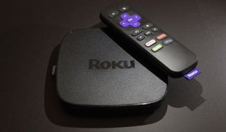 FILE - This Nov. 16, 2016 file photo shows the Roku Premiere streaming TV device in New York.  Roku plans to add a voice-controlled digital assistant to expanding lineup of online video players in an attempt to catch up with Google, Apple and Amazon. The internet-connected assistant will focus exclusively on fielding spoken request about video, music and other tasks tied to entertainment.  (AP Photo/Patrick Sison, File)