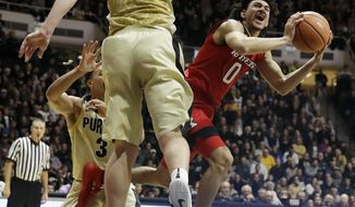 Rutgers' Geo Baker (0) shoots against Purdue's Isaac Haas (44) during the first half of an NCAA college basketball game Wednesday, Jan. 3, 2018, in West Lafayette, Ind. (AP Photo/Darron Cummings)