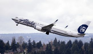 In this Tuesday, March 24, 2015, file photo, an Alaska Airlines jet takes off at Seattle-Tacoma International Airport in SeaTac, Wash. (AP Photo/Elaine Thompson, File)