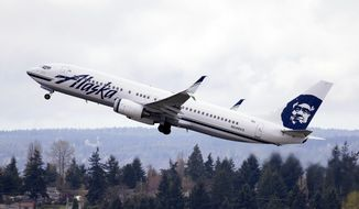 FILE - In this Tuesday, March 24, 2015 file photo, an Alaska Airlines jet takes off at Seattle-Tacoma International Airport in SeaTac, Wash. A San Diego man banned from Alaska Airlines for touching a flight attendant says he's a victim of discrimination against men. Mike Timon tells the San Diego Union-Tribune the airline banned him, saying he touched the female flight attendant on the buttocks on a flight from Oregon to San Diego last week. Timon says he only touched the woman politely on her back to get her attention.  (AP Photo/Elaine Thompson, File)