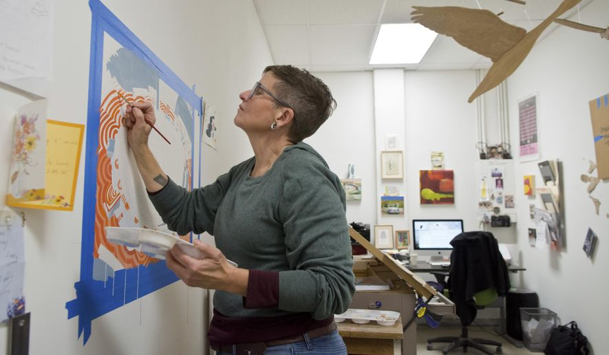 """In a Dec. 14, 2017 photo, Sheri Crider works in her studio in Albuquerque, N.M. Crider is the owner of Sanitary Tortilla Factory, in Albuquerque, N.M. She organized a sketchbook-exchange program between local artists, Working Classroom students at Albuquerque's South Valley Academy and girls in juvenile detention. The results of the sketchbook-exchange project, which continued for three months, were displayed Dec. 9 in """"The Story of Ourselves,"""" an exhibit at Sanitary Tortilla Factory.   (Marla Brose/The Albuquerque Journal via AP)"""
