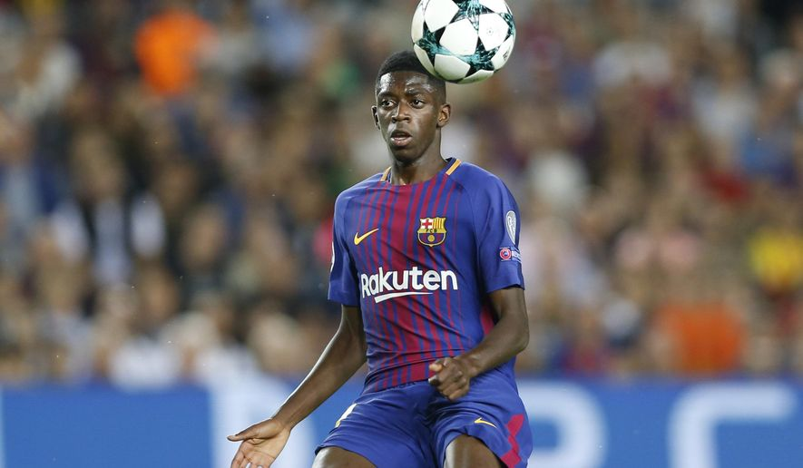 FILE - In this Sept. 12, 2017 file photo, Barcelona's Ousmane Dembele chases the ball during a Champions League group D soccer match between FC Barcelona and Juventus at the Camp Nou stadium in Barcelona, Spain. Dembele, the club's most expensive signing ever, is expected to make his much-anticipated return from a long injury layoff in a Copa del Rey match at Celta Vigo on Thursday Jan. 4, 2018. (AP Photo/Francisco Seco, File)