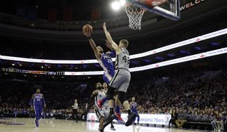 Philadelphia 76ers' Ben Simmons (25) goes up for a shot against San Antonio Spurs' Davis Bertans (42) during the first half of an NBA basketball game, Wednesday, Jan. 3, 2018, in Philadelphia. (AP Photo/Matt Slocum)