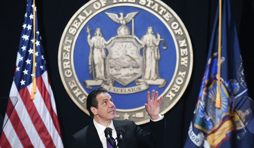 New York Gov. Andrew Cuomo makes reference to his father Mario Cuomo as he delivers his state of the state address at the Empire State Plaza Convention Center on Wednesday, Jan. 3, 2018, in Albany, N.Y. (AP Photo/Hans Pennink)