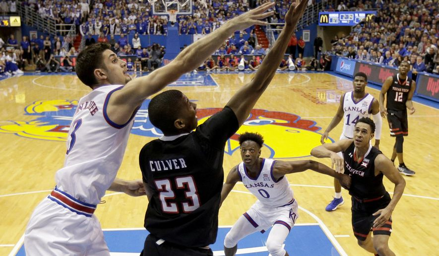 Texas Tech's Jarrett Culver (23) shoots under pressure from Kansas' Sam Cunliffe during the second half of an NCAA college basketball game Tuesday, Jan. 2, 2018, in Lawrence, Kan. Texas Tech won 85-73. (AP Photo/Charlie Riedel)