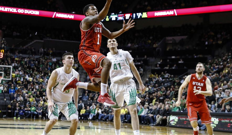 FILE - In this Dec. 29, 2017, file photo, Utah guard Justin Bibbins (1) drives to the basket against Oregon during an NCAA college basketball game, in Eugene, Ore. Utah seemed on shaky ground after an 8-3 start that failed to feature a significant win and saw tough losses against UNLV, Butler and BYU. The Utes, however, swept their Pac-12 opening road series against Oregon and Oregon State. Utah played its best ball over the weekend behind transfer Justin Bibbins and will find out if it was a fluke this week against No. 14 Arizona and No. 4 Arizona State.(AP Photo/Thomas Boyd, File)