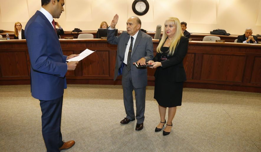 Nintey-three year-old WWII Veteran Vito Perillo, center, is sworn in as mayor of Tinton Falls, N.J., by Senator Vin Gopal, left,  during ceremony at Borough Hall, Tinton Falls,NJ. Anna Mae Perillo was at the side of Perillo during ceremony Tuesday, Jan. 2, 2018. (Noah K. Murray /The Asbury Park Press via AP)