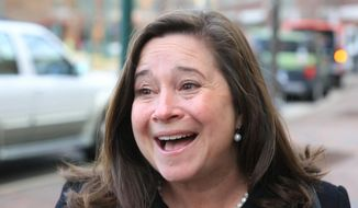 FILE - In this Tuesday Dec. 19, 2017, file photo, Democrat Shelly Simonds as she reacts to the news that she won the 94th District precincts by one vote after previously trailing incumbent David Yancey by ten votes post-election, following a recount in Hampton, Va. A three judge panel on Wednesday, Jan., 3, 2018,  has rejected a request to reconsider its ruling in an election recount between Republican incumbent state Del. David Yancey and Simonds, that could determine partisan control of the Virginia House of Delegates. State elections officials plan to meet Thursday, Jan. 4, to randomly pick a winner in the contest.  (Joe Fudge/The Daily Press via AP, File)