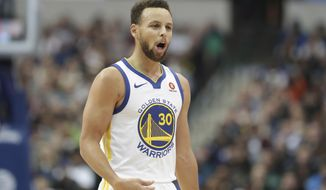 Golden State Warriors guard Stephen Curry (30) reacts to a play during the first half of an NBA basketball game against the Dallas Mavericks in Dallas, Wednesday, Jan. 3, 2018.  (AP Photo/LM Otero)