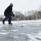 Fabian Olaya, of Woodbridge, Virginia, skates on a pond near the Washington Monument on Thursday.