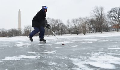 Fabian Olaya, of Woodbridge, Virginia, skates on a pond near the Washington Monument on Thursday.