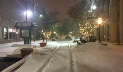 The downtown plaza is empty after a snowfall in Salisbury, Maryland, early Thursday.