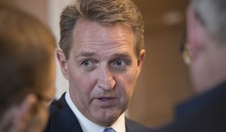 Sen. Jeff Flake, R-Ariz., who announced last year he would not run for re-election in 2018, takes questions from reporters at the Capitol in Washington, Thursday, Jan. 4, 2018.  (AP Photo/J. Scott Applewhite)