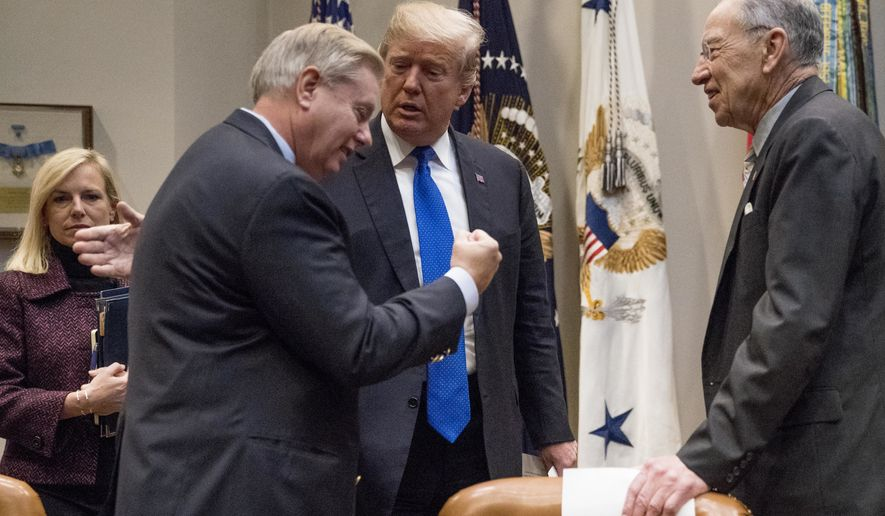 President Donald Trump greets Sen. Lindsey Graham, R-S.C., second from left, and Sen. Chuck Grassley, R-Iowa, right, as they meet to discuss immigration in the Roosevelt Room in the White House, Thursday, Jan. 4, 2018, in Washington. Also pictured is Secretary of Homeland Security Kirstjen Nielsen, left. (AP Photo/Andrew Harnik)