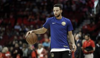 Golden State Warriors' Stephen Curry warms up before an NBA basketball game against the Houston Rockets Thursday, Jan. 4, 2018, in Houston. (AP Photo/David J. Phillip)