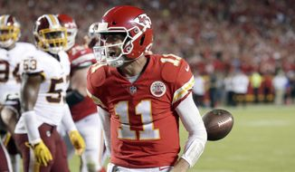 FILE - In this Oct. 2, 2017, file photo, Kansas City Chiefs quarterback Alex Smith (11) celebrates his touchdown during the second half of an NFL football game against the Washington Redskins in Kansas City, Mo. The Jaguars, Bills and Titans all ended long droughts to return to the playoff party. (AP Photo/Charlie Riedel, File) **FILE**