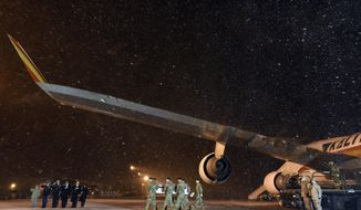 An Army carry team moves a transfer case containing the remains of Sgt. 1st Class Mihail Golin at Dover Air Force Base, Del., on Wednesday, Jan. 3, 2018. According to the Department of Defense, Golin, 34, of Fort Lee, N.J., died Jan. 1, 2018, in Nangarhar province, Afghanistan, after being engaged by enemy fire while on a dismounted patrol. (AP Photo/Steve Ruark)