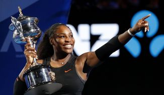 FILE - In this Jan. 28, 2017 file photo, United States' Serena Williams gestures as she holds her trophy after defeating her sister Venus in the women's singles final at the Australian Open tennis championships in Melbourne, Australia. Williams, defending champion has withdrawn from the 2018 Australian Open, saying she is not ready to return to tournament tennis.(AP Photo/Dita Alangkara, File) **FILE**