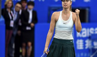In this photo provided by China's Xinhua News Agency,  Maria Sharapova of Russia celebrates after winning a quarter final match against Zarina Diyas of Kazakhstan at the WTA Shenzhen Open tennis tournament in Shenzhen, south China's Guangdong Province, Jan. 4, 2018. (Mao Siqian/Xinhua News Agency via AP)