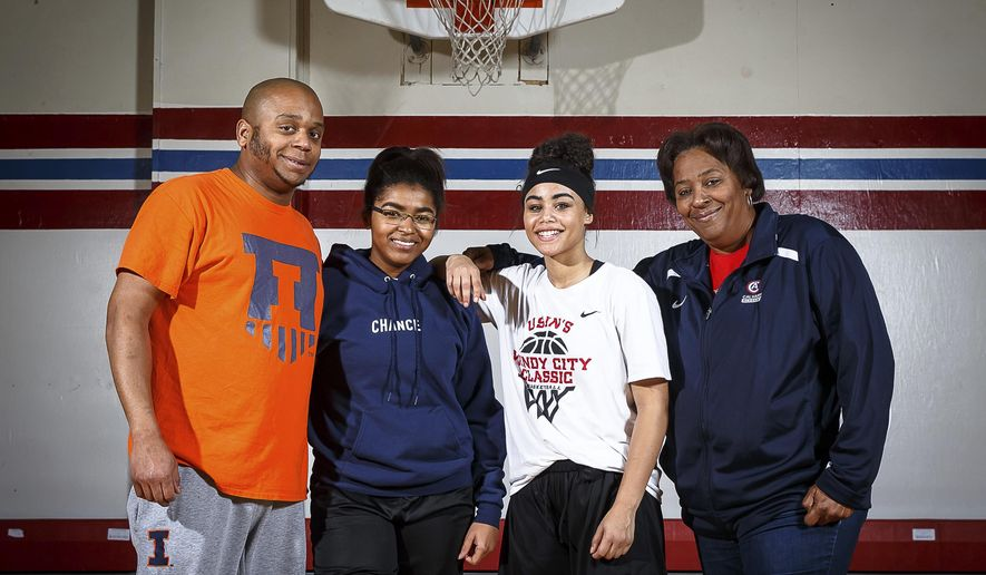 "In this Dec. 15, 2017 photo, Calvary Academy girls basketball is a family affair with, from left,  head coach Terrance Paulin, his players and sisters Alliyah Turner, Aryanna Harris along with their mother and assistant coach Margaret Paulin, all part of the team. ""When we're on the court, I'm 'Coach,'"" Terrance said. ""When we're not here, I'm big brother."" Outsiders might think it odd that he coaches his sisters, but Turner doesn't know any different. That's the way it's always been.(Justin L. Fowler/The State Journal-Register via AP)"