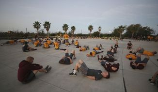 The Texas A&M University at Galveston Corps of Cadets work out during early morning physical training in Galveston, Texas, on Wednesday, Nov. 15, 2017. The Corps of Cadets gathers at 05:45 every Wednesday for a workout. Although some cadets have to participate in the corps as a requirement for their major, 80 percent are expected to come out of the corps and go into service, whether that be Navy or Merchant Marines. (Kelsey Walling/The Galveston County Daily News via AP)