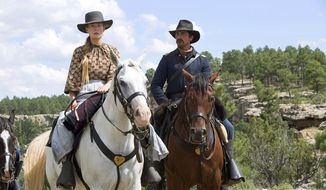 "Rosamund Pike and Christian Bale star in ""Hostiles, featuring a circa 1892 Army captain protecting a Cheyenne chief against every instinct in his bones. (Associated Press/File)"