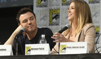 """FILE - In a Saturday, July 22, 2017 file photo, Seth MacFarlane, left, and Adrianne Palicki attend the """"The Orville"""" panel on day three of Comic-Con International, in San Diego. The Fox broadcasting network, home to """"The Simpsons"""" and """"The Orville,"""" will continue to carry scripted entertainment after its sale to Disney.Fox Television Group CEOs Dana Walden and Gary Newman said the announced sale that will split up Fox and the 20th Century Fox studio won't turn Fox into a platform solely for sports and other live programming. In Dec. 2017, Disney said it was buying a large part of the Murdoch family's 21st Century Fox for about $52.4 billion in stock, including its film and TV studios and cable and international TV businesses.  (Photo by Al Powers/Invision/AP, File)"""