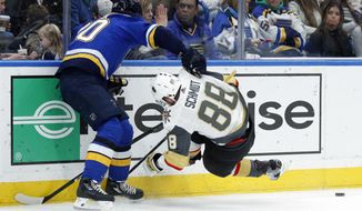 Vegas Golden Knights' Nate Schmidt (88) falls against the boards while chasing a loose puck with St. Louis Blues' Alexander Steen, left, during the second period of an NHL hockey game Thursday, Jan. 4, 2018, in St. Louis. (AP Photo/Jeff Roberson)